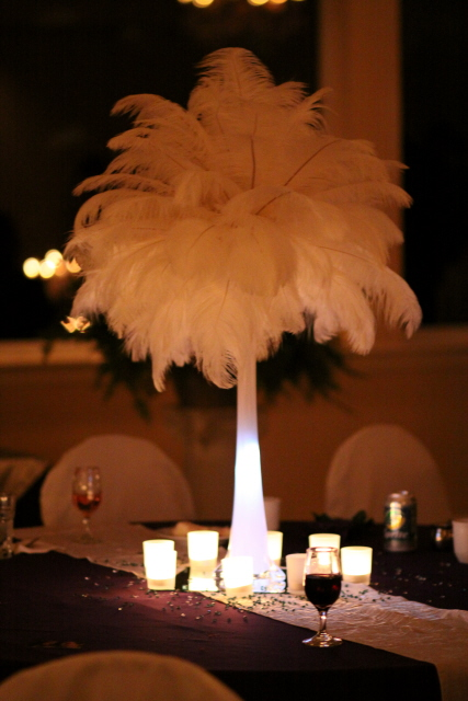 DIY wedding centerpiece was made out of white ostrich feathers
