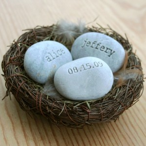 Engraved stones in a bird's nest cake topper