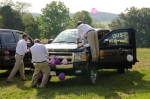 Groomsmen work on Car